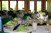 Sky Ridge Pavilion provides seating for up to 150 guests, wall of windows overlooking Cedar Creek, fire place and covered terrace.