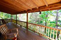 Private covered porch with rockers, swing and views