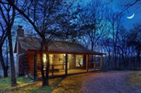 Themed 650 sq. ft. fully-furnished cabins with covered porch & fireplace