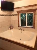 Huge soaker tub with bluff view and flat screen tv