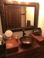 Custom vanity and copper sink in master bath