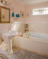 Relax in the Chantilly Rose Room Tub