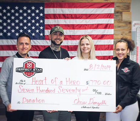 Heart of a Hero Donation Check photo with Perfect Star HVAC Staff 2019