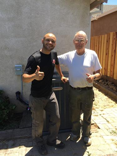 Lead Service Technician, Gilbert Caceres with a very satisfied client after installing a new Lennox heating and air conditioning system.