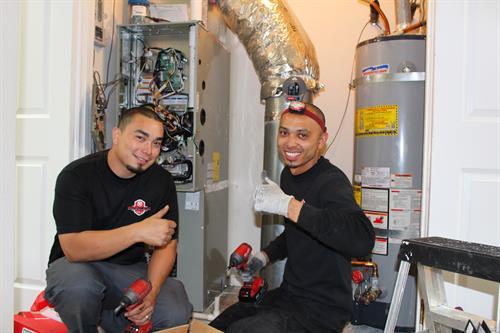 Lead Install Technicians, David Mendoza & Gilbert Caceres installing a new HVAC system in Blackhawk Danville, CA