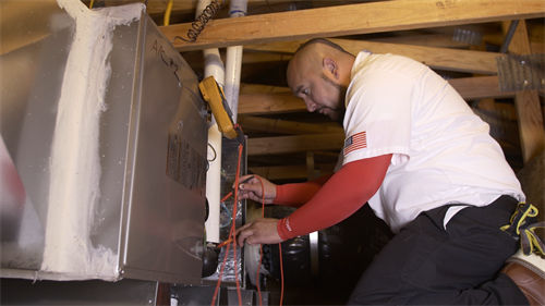 Senior Comfort Adviser, Danny Mendoza servicing a client's furnace in Brentwood, CA
