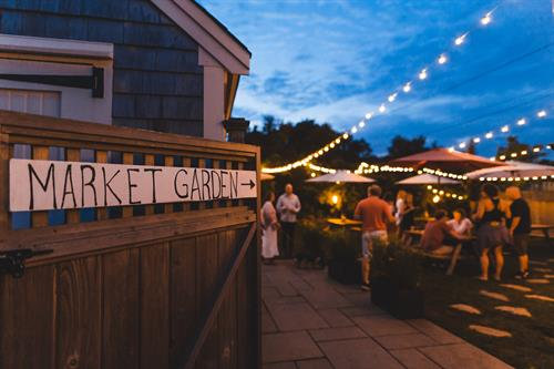 Gallery Image ACK_market_garden_sign_and_people.jpg