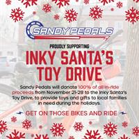 "Sandy Pedals ""Get on our Bikes and Ride"" for Inky Santa's Toy Drive"