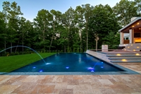 Infinity edge pool and spa with water features