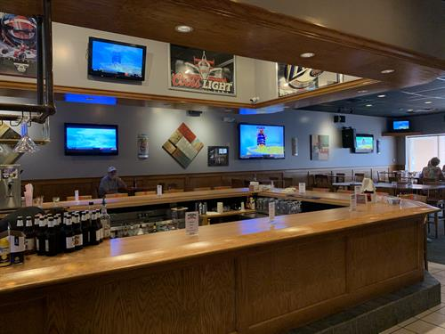 Separate bar room with full service, tv's and seating.