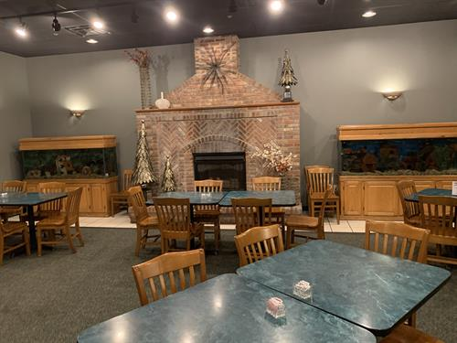 Fireplace and aquariums in our main dining room.