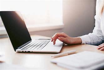 Gallery Image female_laptop_white_shirt_single_hand.jpg