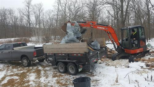 Loading scrap metal from a trailer demolition in Wilkes Barre, PA
