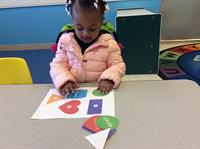 Children were encouraged to match up the shapes and colors and say what they were matching....color and shape.