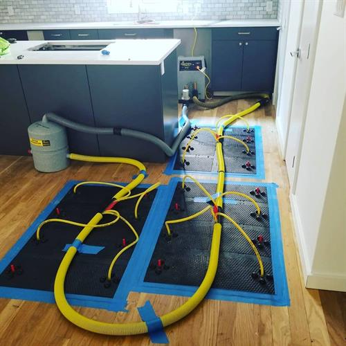 Here is our injectidry floor mat system on a customers warped floor.  This floor was completely saved and did not need replacement.