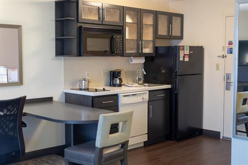 Fully equipped kitchens.  Two burner stove-top, dishwasher, microwave, disposal and full size refrigerator.