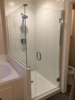 We refinished the tile and installed this beautiful clear shower enclosure.