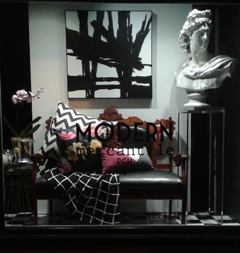 Window featuring local art and pillows