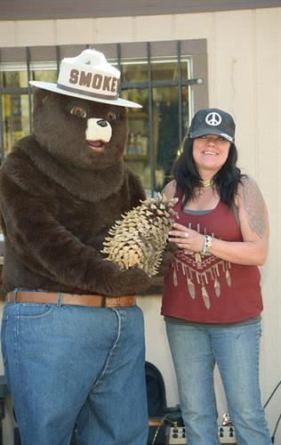 Smokey Bear with record breaking coulter pine cone winner Lori from Big Bear
