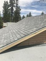 This customer loves his new roof by Reza's!