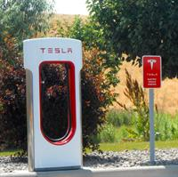 Tesla Charging station located in our parking lot