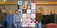 City Council members posed for a photo with the All-America City quilt that traveled the country in early 2012.