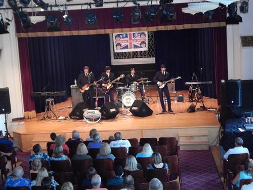 Toppermost performing on Hartland Music Hall's stage