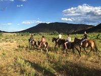 Horseback riding on open range on the Chuckwagon Adventure