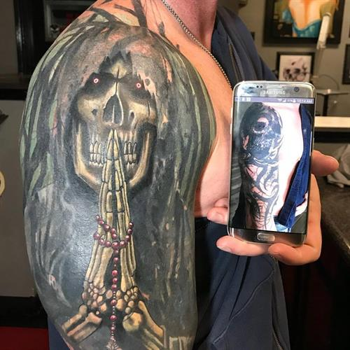cover up tattoo By Pete Salais Owner of Pistol Petes Tattoo Saloon