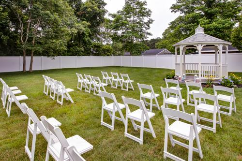 We have a side yard that can be used for outdoor events. We can also put up a white event tent over the grass.