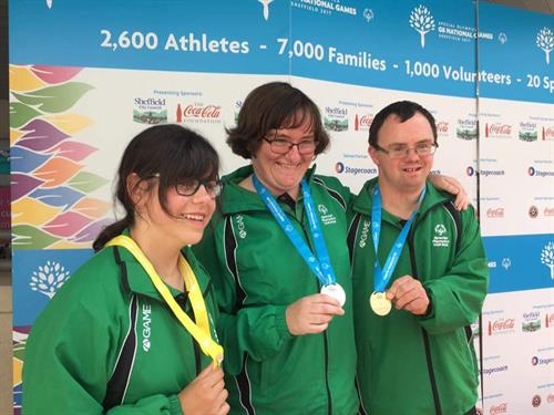 Shikira, Catherine and Sean showing off their medals
