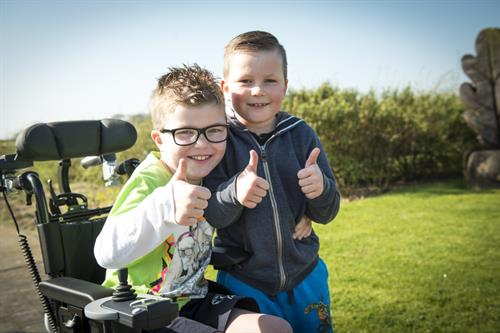 Gallery Image Boy_with_brother_thumbs_up_01.jpg