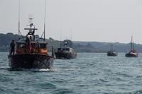 Falmouth Harbour pit-stop as historic lifeboats head for RNLI's Penlee Commemoration