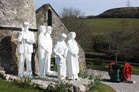 Gallery Image Clay_worker_statues_(Wheal_Martyn).jpg