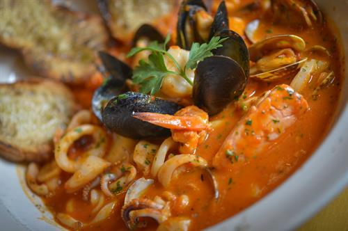 Shrimp, clams, mussels, calamari, scallops and fish sautéed in tomato, garlic and white wine, served with toasted Italian bread