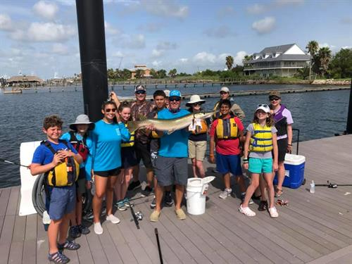 """Summer  Campers and their 36"""" alligator gar caught off SSBG private docks.  Of course we threw him back, but wow!"""