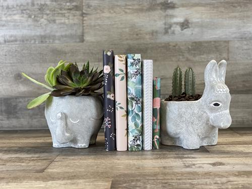 You'll find many fun, functional sculptures, as well as florals and many home accents.