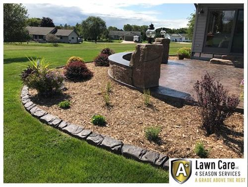 Landscape concrete edging, plantings, paver patio