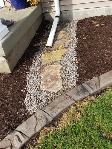 Landscape concrete edging, rock, mulch