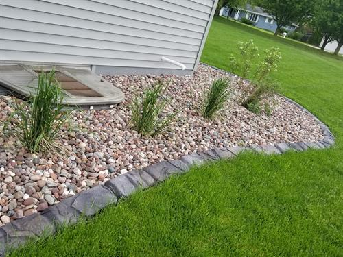 Landscape concrete edging, rock and plantings