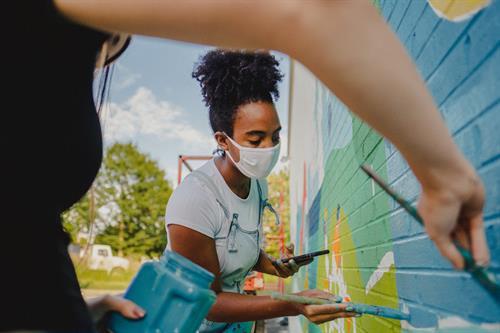 Co-muralist Xaivier Ringer