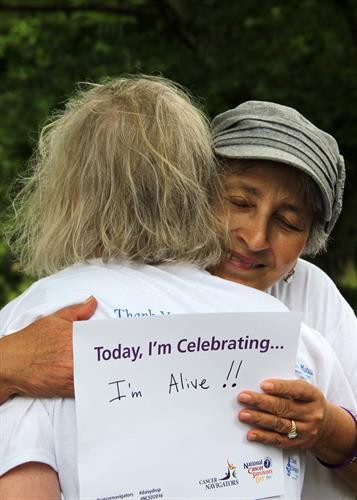 Cancer Navigators' counselor hugging a cancer survivor