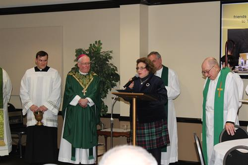 Mrs. Bucki delivers the proclamation on behalf of the Amherst Chamber of Commerce at the grand opening ceremony with Bishop Malone at St. Leo's Parish Center