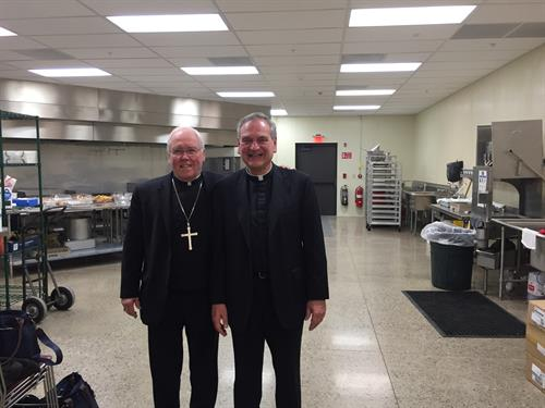 Bishop Malone with Msgr. Zapfel in St. Leo's new state of the art teaching kitchen