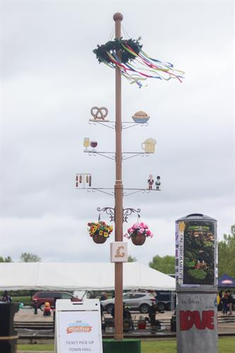 Midwest Maifest maibaum and advertising column