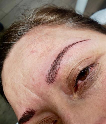 Traditional microblading. Not everyone is a good candidate for this technique. Try Nano brows... realistic looking with better and longer retention.