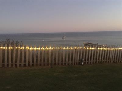 Fairy lighting on fence for a wedding at Paradise Cove