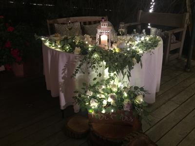 Lighting for the head table at a wedding