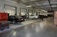 Complete auto shop with five 2-post lifts, waste oil and coolant collection and auto specific tools
