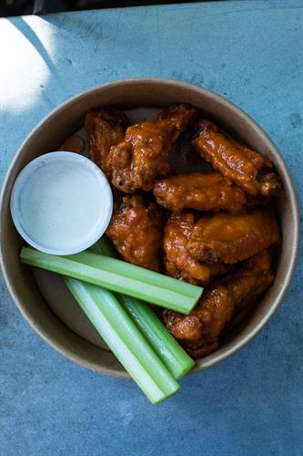 tasty buffalo wings with buttermilk blue cheese dip